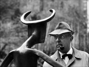 french-actor-jacques-tati-looking-at-a-sculpture.jpg